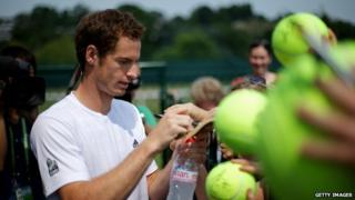 Andy Murray signs autographs.