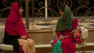 Malala Yousafzai (left) and Shazia Ramzan chat after meeting for the first time last week since the attack on Malala in October