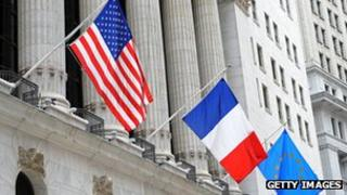 US, French and EU flags at the New York Stock Exchange