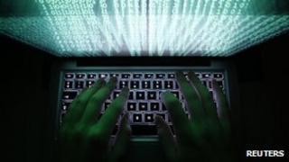 File photo: a man typing at a computer keyboard