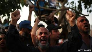 Supporter of ousted President Mohammed Morsi in Cairo, Egypt (8 July 2013)