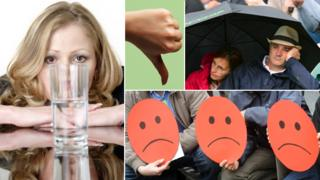 "A composite including: a woman looking at a half fully or half empty glass; a thumb pointing down; two people under an umbrella looking glum; and three unhappy ""smiley"" faces"