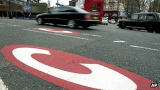 A car drives past a congestion charge mark on a London road