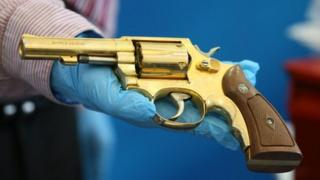 A replica golden gun was displayed as part of the dissident weapon haul