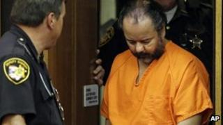 Ariel Castro is led into Cuyahoga County Common Pleas Court in Cleveland for a pretrial hearing 3 July 2013