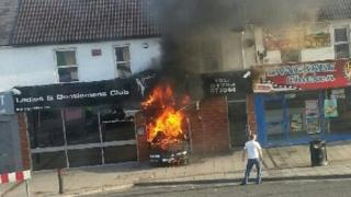 A car ablaze inside the entrance of Dream Lounge in Swindon