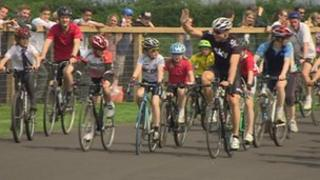 Sir Chris Hoy cycles around the Odd Down track