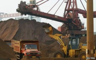 Truck being loaded with iron ore at Nantong harbour