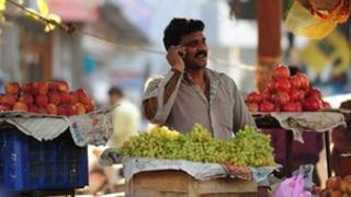 Fruit seller on the phone