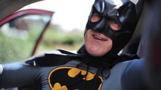 Mark Wells inside the Batmobile