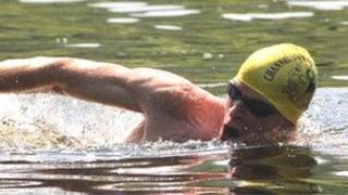 Powys GP James Wrench swimming