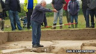 Sir Barry Cunliffe explaining the site