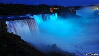 Visitors to Niagara Falls receive notice of the sex of the royal baby indicated by the blue light illuminating the falls in Niagara Falls, New York
