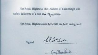 A notice formally announcing the birth of a son to the Duke and Duchess of Cambridge, is placed in the forecourt of Buckingham Palace