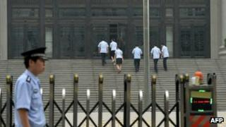 Police stand guard outside the Intermediate People's Court where Chinese politician Bo Xilai was indicted and his case expected to be heard in Jinan, Shandong province on 25 July 2013