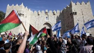 Israeli and Palestinian flags outside Damascus Gate, Jerusalem (file photo)