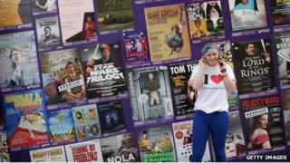 Girl in front of Edinburgh Fringe posters