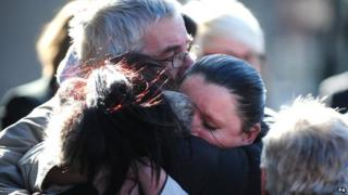 Jimmy Duffy, the father of Mairead Philpott, hugs daughters Bernadette and Jennifer
