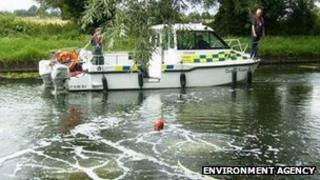 Environment Agency staff treating the River Cam
