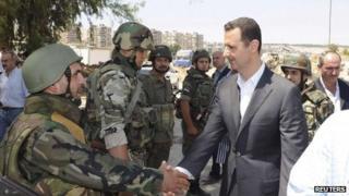 President Bashar al-Assad in Daraya, south-west of Damascus on 1 August