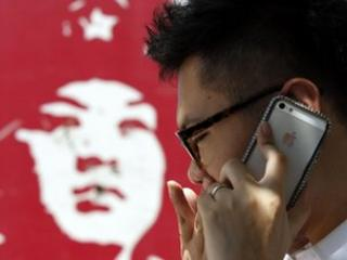 Chinese man using iPhone