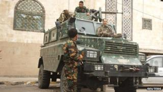 Police troopers secure a street leading to the British embassy in Sanaa on 5 August 2013