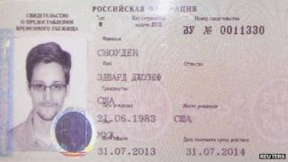 Edward Snowden's new refugee documents granted by Russia seen at a news conference in Moscow on 1 August 2013