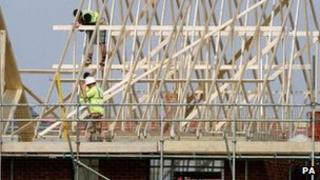 Builders working on roof