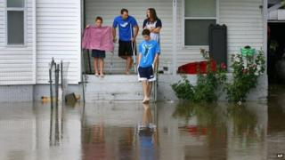 A family declined evacuation orders as a creek overtopped its banks in downtown Newburg, Missouri, on 7 August 2013