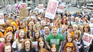 Group of red haired people with banners
