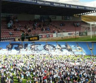 Not many fans decided to turn up at the Northampton game (top) compared to the charity match at the Ricoh Arena
