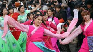 People of Chinese descent perform an ethnic Chinese dance to celebrate the Lunar New Year in Japan's largest Chinatown in Yokohama, suburban Tokyo, 17 February 2013