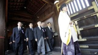 Japanese lawmakers visit the Yasukuni Shrine in Tokyo on 15 August 2013