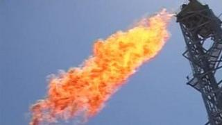 Flame spewing from offshore oil drill