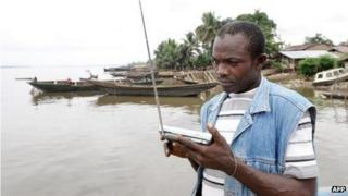 A Bakassi resident listening to the radio in 2008, Cameroon