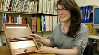 Powys council archive assistant Kerry Jones with the scroll