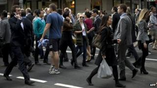 Pedestrians cross an intersection Sydney on June 13, 2013