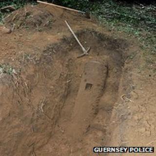 A half-buried WWII bomb