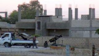 Kurdish fighters clash with al-Nusra militiamen near the Turkish border, 2 Aug