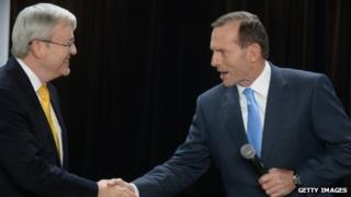 Prime Minister Kevin Rudd (L) and opposition leader Tony Abbott shake hands at the Peoples Forum debate on 21 August 2013 in Brisbane, Australia