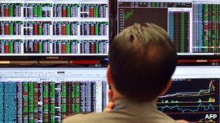 An trader looking at market boards