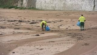 Beach cleaners on a beach in Thanet