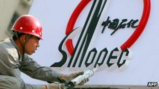 A Chinese worker installs Sinopec logo