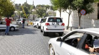 UN vehicles transport a team of weapons experts to the scene of a suspected chemical attack on 26 August 2013