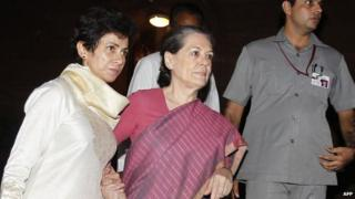 Sonia Gandhi (second from right) is supported by minister Kumari Selja as she leaves parliament for hospital on in August 26, 2013