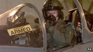 An RAF Harrier pilot checks his aircraft at Gioia del Colle Air Force Base in 1999 before a bombing raid on Serbian targets