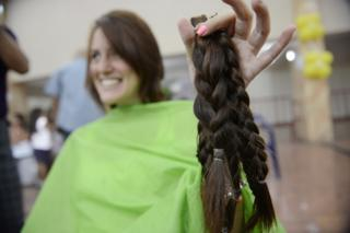 Venezuelan hair cut off for charity