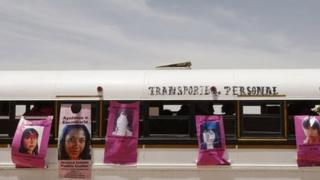 A bus is pasted with posters with pictures of women who went missing, during the burial ceremony of the remains of Brenda Berenice Castillo at San Rafael municipal cemetery, on the outskirts of Ciudad Juarez, 8 June, 2013.
