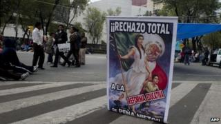 "A placard at a CNTE protests calls for ""total rejection"" of the reform"