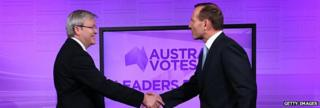 The two leaders of the main parties shake hands at the first debate